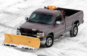 A truck plowing snow